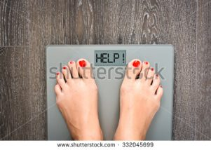 stock-photo-lose-weight-concept-with-person-on-a-scale-measuring-kilograms-332045699